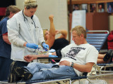 Red Cross Worker Pennie Rockhold collects blood from Kris Kennedy during the drive.