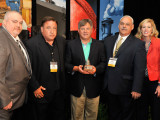 Northeast Section IVP D. David Haggerty, center, presents L-154 delegates with a Capitol Dome Award for achieving the highest CAF donations by a local. Left to right, delegates Tom McKittrick, Paul Price, IVP Haggerty, Ray Doria, and D-PA Bridget Martin.