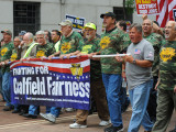 IVP Dave Haggerty, far right in gray shirt, marches on the front line with UMWA officers.