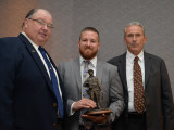 L-169's Jonathon Nevedal accepts the first place award as top graduate apprentice for 2015 from BNAP National Coordinator Marty Spencer, left, and IVP Larry McManamon (Secretary, National Joint Apprenticeship Board).