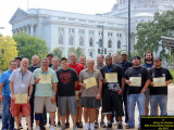 Graduates of the 58th Annual Summer Institute Basic Course in Madison, Wis., stand with their certificates in front of the state capitol July 17.