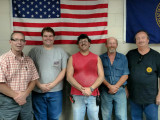 "L-D561 negotiating committee members, l. to r., Jim Rhedin, Kermit Gates, Scott Schreiner, Ernie West and Rolland ""Kit"" Cooper."