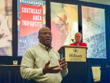 TVA Senior Program Manager for Industrial Relations Jerry Payton speaks about the Boilermaker Code during a presentation by MOST National Administrator Skipper Branscum (background).