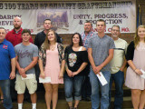 Local 83 scholarship winners, left to right: Trustee Chairman Casey Jensen; President Robbie Grant; BM-ST Scot Albertson; Cody Anschutz, son of Wade Anschutz; Recording Secretary Zach Hayes; Marissa Riddle, daughter of Lori Manroe; Lori Manroe; Inspector John Seward; Garrett Helmich, son of Billie Helmich; Billie Helmich; Jordyn Corn, daughter of Jeff Kuzelka; and Jeff Kuzelka. Not pictured: Jordan Elam, son of Richard Elam.