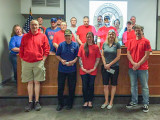 Members of Local 158 wear red to raise funds for Honor Flights. They donated $2,100 to Honor Flights at their May meeting.