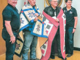 Two retired L-60 members receive a handmade quilt from the non-profit Quilts of Valor to thank them for their service during the Vietnam War. L. to r.: Rod Johnson, L-60's John Williams and Jack Cooper, and Terry Johnson.