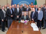 Washington Gov. Jay Inslee signed ESHB 1817 into law on May 8, 2019. Attending the signing were State Rep. Mike Sells, primary sponsor of the bill and chair of the Committee on Labor and Workplace Standards. Also attending were state senators Rebecca Saldaña, Jesse Salomon and Steve Conway; Washington State AFL-CIO President Larry Brown; WBCTD Legislative Director Neil Hartman; WBCTD Executive Secretary Mark Riker and Luke Esser, government affairs. The Western States Boilermakers attending were IVP-WS J. T