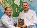 D-NRS-CSO Tim Simmons, left, presents a retirement gift from the Boilermakers to Dave Douin, Boilermaker and outgoing executive director of the National Board of Boiler and Pressure Vessel Inspectors.