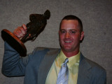 Matthew Avery of L-85 (Toledo, Ohio) raises his first-place trophy during the 2008 National Outstanding Apprenticeship Award banquet held in Kansas