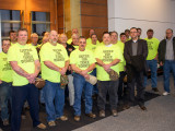 Four terminated Terex employees (front row, yellow shirts) stand with union supporters outside a federal courtroom February 17 in Minneapolis. Boilermakers' organizer Jody Mauller is fifth from left.