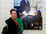 Stefanie Hamilton pauses in front of a welding photo at the Northern Alberta Institute of Technology in Edmonton.