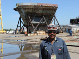 L-1814 President Chris Burnett stands near the bow section of an LPD ship under construction at the Avondale shipyard in 2009.