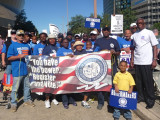 L-1814 members march near the Superdome with other unions and supporters to keep