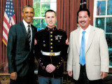 L-28 apprentice and Marine guard Justin Hynes stands with his father, Franny, and President Barack Obama.