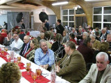 Over 100 people attend Local 34's Christmas party in Topeka, Kan., including retired Intl. Vice Pres. Joe Stinger (pictured at right in off-white jacket).
