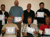 Local 359 members earn certificates for attending a steward training program Aug. 26 conducted by Intl. Rep Richard MacIntosh and L-359 Bus. Agent Ken Noga. L. to r., front row: Al Dingwall, Paul Nemeth, Bill Nelson; back row: Roy Greenshields, Peter Kvenich, Noga, and Ross Kirkpatrick.