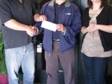 L-555 Business Rep Ted Stark, l., accepts a $5,000 check to fund a new award for