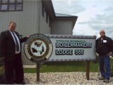 Local 555 BM-ST Dallas Rogers (l.) stands with his father, Doug, a retired Boilermaker and former lodge council member, outside the lodge's newly-purchased union hall in Winnipeg.