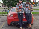 Sean Richardson, left, and Keven Michaud, L-73, pause during their ride across Canada to raise awareness of the veteran suicide rate.