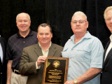 istrict 57 BM-ES Ed Vance, second from right, accepts the top NACBE safety award