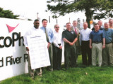 Reps for 10 unions, including Boilermakers Local 483, join company reps, state Sen. Bill Haine, and state Rep. Dan Beiser in a display of solidarity following the signing of a seven-year contract extension at the Conoco-Phillips refinery in Roxana, Ill.