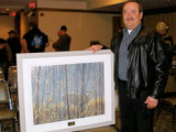 Intl. Rep Norm Ross accepts a Robert Bateman print from the members of Local 555 in Winnipeg, Manitoba.