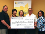 Local 203 officers and staff present a $50,000 check to Rose Daley (far right) of the Daffodil Place Campaign. L. to r., BM-ST Tom Walsh, Darlene Ryan, Heather Greely, and Pres. Bill Healey.