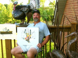 L-40 retiree Frank Linton displays two of his paintings and samples of his metal art — a life-size turkey and sculpture of Blue Heron.