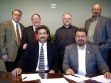 Signing a three-year agreement for the Western States Area are, l. to r., seated: chairmen Larry Jansen (employer) and Tom Baca (union); standing, employer co-chairman Jerry Bennett and secretary Tom Dillon, and union secretary David Bunch and co-chairman Kyle Evenson.