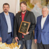 Clinton Penny, BM-ST of Local 11, accepts the John F. Erickson NACBE Safety Award on behalf of his lodge during the 2020 Construction Sector Operations conference. L. to r. are IVP-WS J. Tom Baca, Penny, NACBE Executive Director Ron Traxler and IP Newton Jones.
